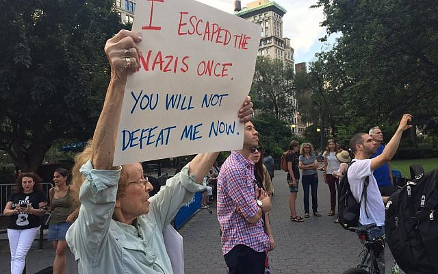 "89-year-old Marianne Rubin protesting in New York after the Charlottesville white supremacist rally in August 2015. She said, ""I went to let people know that what I went through must never happen again."" Photo by Alex Bazeley."