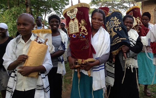Ugandan Jews carrying Torah scrolls (Courtesy of Be'chol Lashon via JTA)