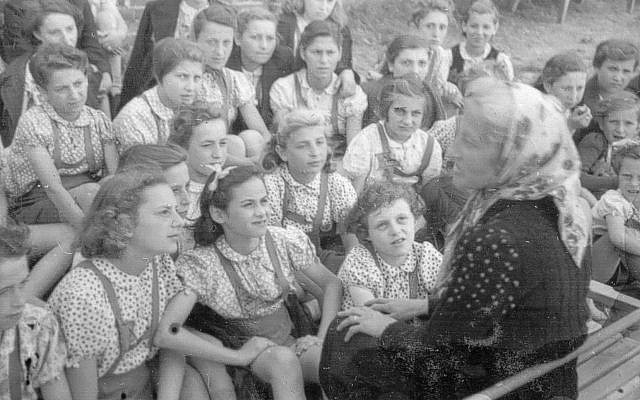 Pupils from Rumkowski High School in the Lodz Ghetto with teacher and principal Stella Rein on a field trip to Marysin, the ghetto's agricultural area, 1941-1942. Source: Yad Vashem