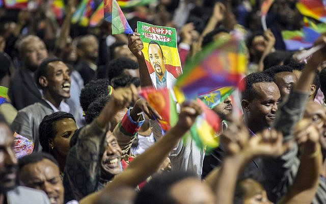 Ethiopians wave during an event celebrating reconciliation with Eritrea in Addis Ababa, Sunday  July 15, 2018. (AP photo Mulugeta Ayene)