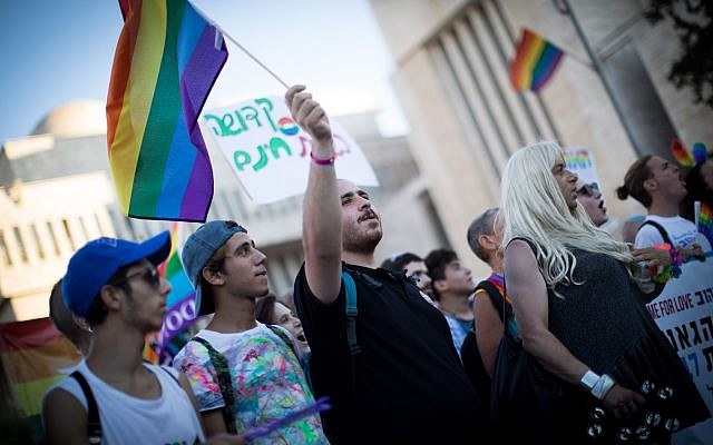 People participate in the annual Gay Pride parade in central Jerusalem, under heavy security on August 3, 2017. (Flash90/Yonatan Sindel)