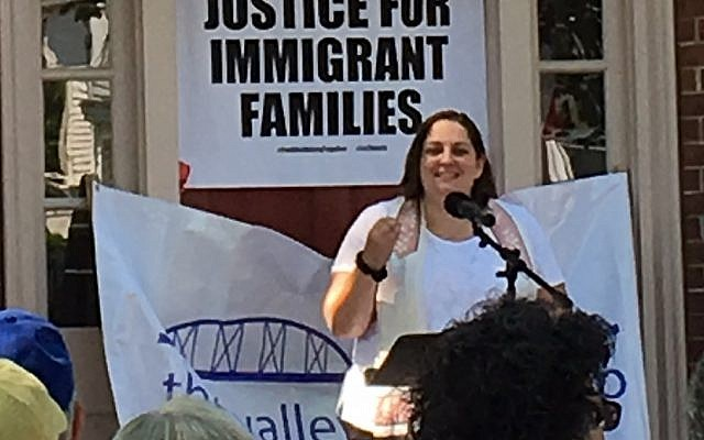 Rabbi Bellows speaks at a Families Belong Together Rally in Deep River, CT. Photo credit: Bruce Josephy