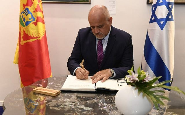 Prof Dr. Srdjan Darmanovic, Foreign Minister of Montenegro, signing the guest book at the Israeli President's Residence (photo by Israeli Ministry of Foreign Affairs; used with permission)