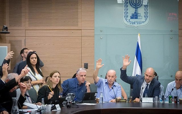 Illustrative. Knesset members vote on amendments to the proposed Jewish nation-state bill at the Knesset, July 16, 2018. (Miriam Alster/Flash90)