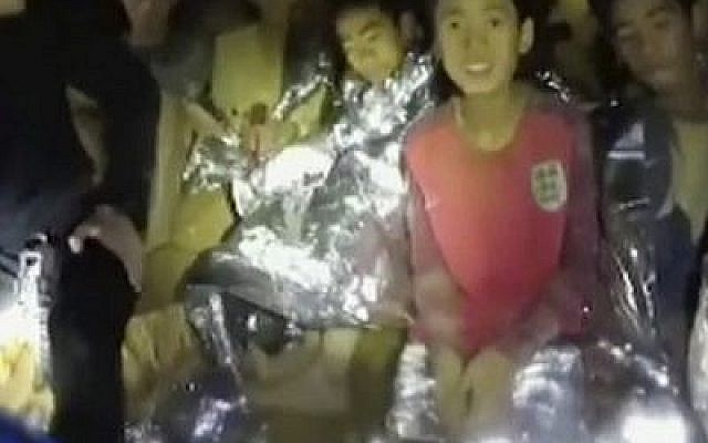 Thai boys are with Navy SEALs before their dramatic rescue. Thailand, July 3, 2018. (Thai Navy Seal via AP)