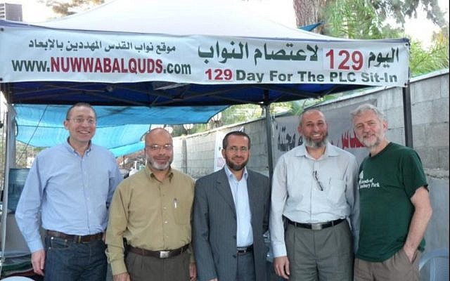 UK Labour leader Jeremy Corbyn (right) pictured in Jerusalem alongside Labour MP Andrew Slaughter (left), and Hamas officials Ahmad Attoun, Khaled Abu-Arafah, and Muhammad Totah. (Credit: i24News via Jewish News)