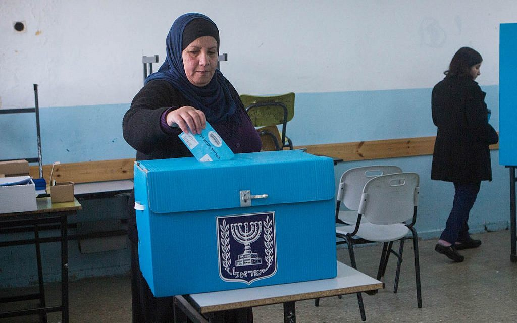 Israeli-Arabs cast their votes at a polling station in the Arab town of Beit Safafa, on March 17, 2015, in the Israeli general elections for the 20th parliament. (FLASH90/Miriam Alster)