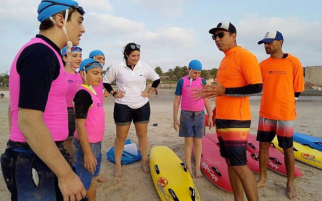 Trained instructors motivate young Nippers to try out new surf and beach skills