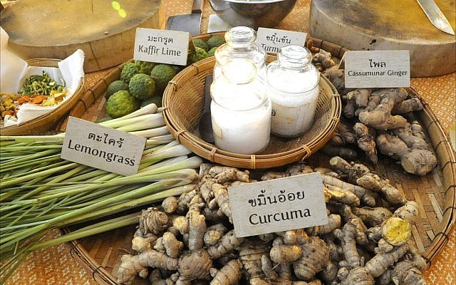 Organic spices and herbs decorate a lunch table at Thailand's Sampran Riverside resort. (Larry Luxner)