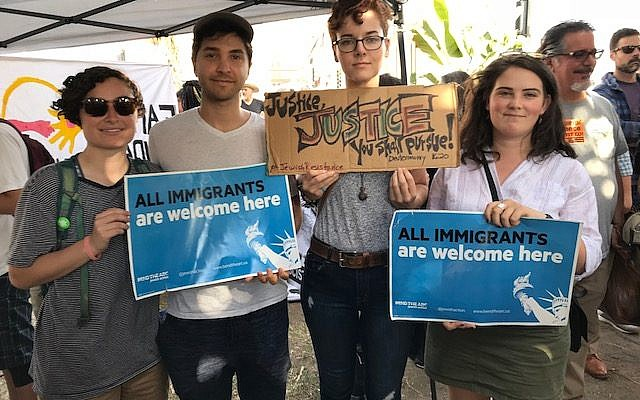 Protesters holding signs at the Families Belong Together March in Los Angeles on June 14, 2018. Left to right: Jenni Shaw, Joshua Jacobs, Rachel Simmons, Shachar Cohen-Hodos. Photo credit: Aryeh Cohen.