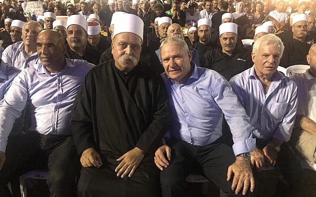 Amos Yadlin, third from left, sits with leaders of Israel's Druze community at a Tel Aviv rally against the controversial nation-state law, Aug. 5, 2018. (Courtesy of Amos Yadlin)