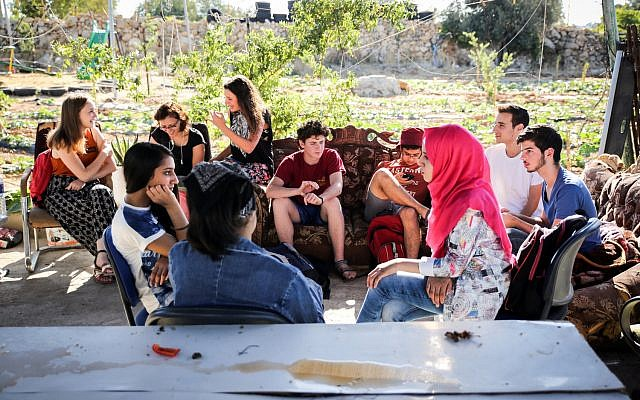 Palestinians and Israelis in dialogue at the Roots Center in the West Bank. (Courtesy of Roots)
