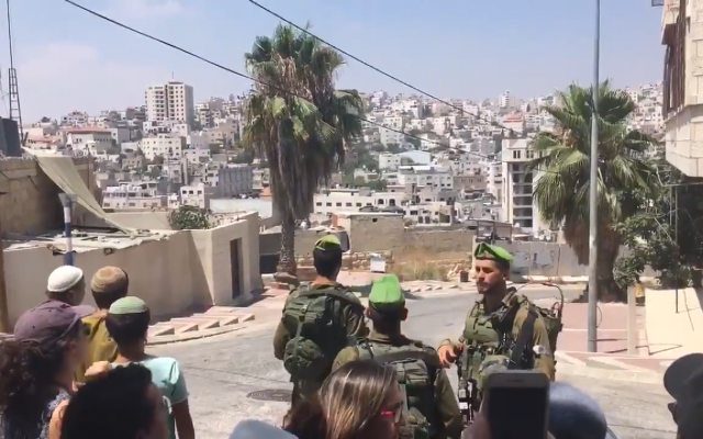 Illustrative. Screenshot from video shows anti-Occupation activists touring the West Bank with Israeli officers. (Source: Jewish News)