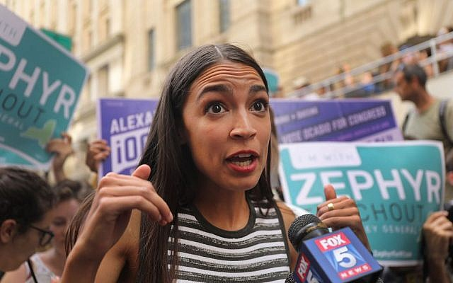 Congressional nominee Alexandria Ocasio-Cortez campaigning for Zephyr Teachout in New York City, July 12, 2018. (Spencer Platt/Getty Images via JTA)