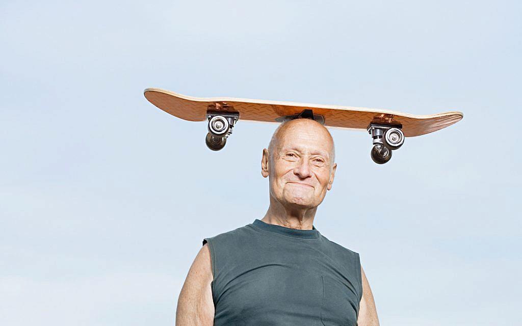 Illustrative: Man with skateboard on his head (via iStock)
