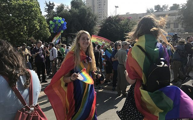 People gather for the annual Pride Parade in Jerusalem on August 2, 2018. (Luke Tress/ Times of Israel)