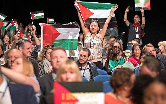 Delegates wave Palestinian flags at the Labour Party's annual conference. (Stefan Rousseau/PA Wire via Jewish News)