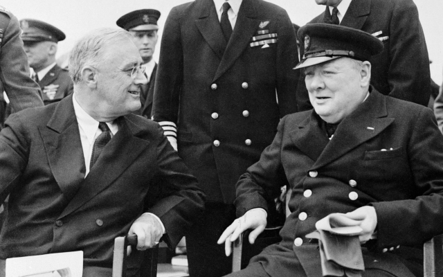 Franklin Roosevelt and Winston Churchill seated on the quarterdeck of HMS Prince of Wales during the Atlantic Conference, 10 August 1941. Admiralty Official Collection.