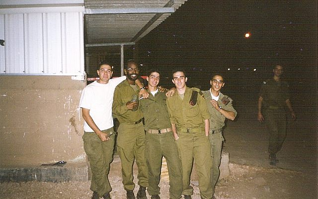 Barack Mandela in the Golani Brigade of the Israel Defense Forces (IDF) with fellow Israeli soldiers during the Second Intifada. (Courtesy)