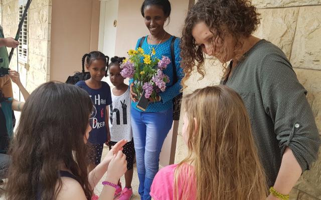 Kibbutz members welcome an asylum-seeking family to their community.