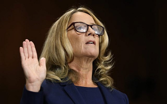 Christine Blasey Ford is sworn in before the Senate Judiciary Committee, Thursday, Sept. 27, 2018 on Capitol Hill in Washington.  The Senate Judiciary Committee will hear from Supreme Court nominee Brett Kavanaugh and Christine Blasey Ford, the woman who says he sexually assaulted her. (Michael Reynolds/Pool Image via AP)