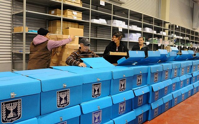 Illustrative: Workers prepare ballot boxes for the upcoming Israeli election at a warehouse near Tel Aviv before they are shipped to polling stations, January 2013. (Yossi Zeliger/Flash90)