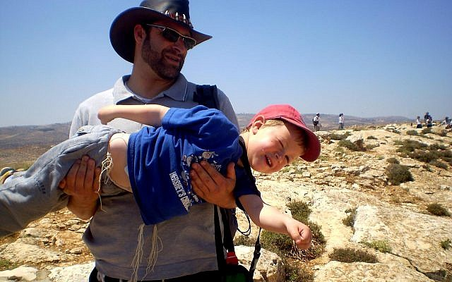 Ari Fuld playing around with his son Natan during a hike on Yom Ha'atzmaut