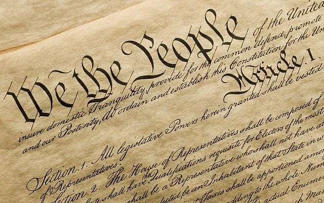 Copy of the cover of the US Constitution (via iStock)