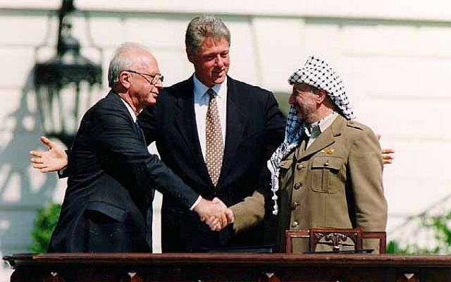 The famous handshake on the White House lawn, between Israeli prime minister, Yitzhak Rabin, and PLO leader Yasser Arafat, as part of the Oslo accords, overseen by US president Bill Clinton, September 13, 1993. (Wikipedia)