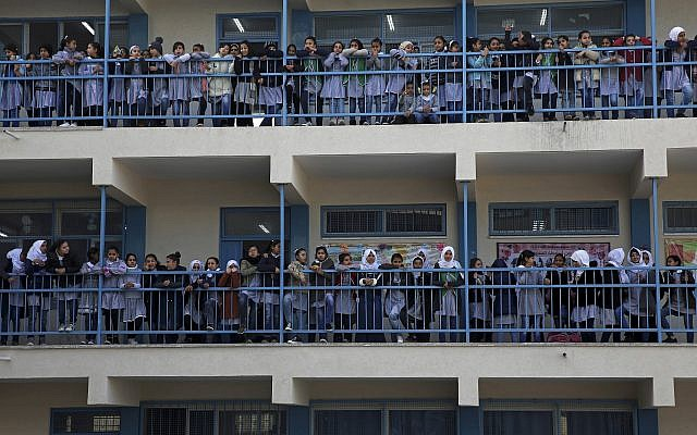 Refugee school girls watch as UNRWA's commissioner-general, Pierre Krahenbuhl, gives a press conference to launch a global campaign to support UNRWA, at the UNRWA Rimal Girls Preparatory School in Gaza City,  January 22, 2018. (AP Photo/Adel Hana)