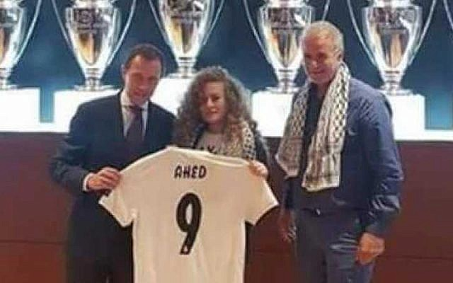 Palestinian activist, who spent eight months in Israeli prison, is welcomed at Bernabeu stadium by the football club.