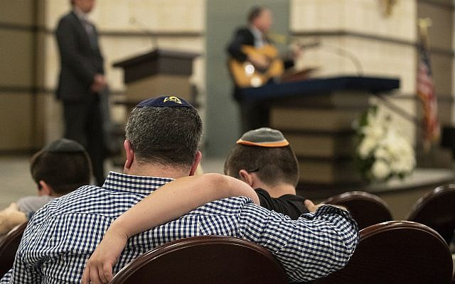 People gather at the B'nai Aviv Synagogue in Weston, Fla., Sunday, Oct. 28, 2018, after Saturday's shooting that took place during worship services inside Tree of Life Synagogue in Pennsylvania. (Jennifer Lett/South Florida Sun-Sentinel via AP via Jewish News)