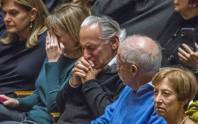 People gather at Soldiers & Sailors Memorial Hall for a vigil to remember the victims of the mass shooting a day earlier at the Tree of Life Synagogue, Sunday, Oct. 28, 2018, in Pittsburgh. (Andrew Rush/Pittsburgh Post-Gazette via AP - via Jewish News)