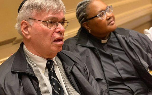 A Pittsburgh Police Chaplain sitting with Rabbi Alvin Berkun.