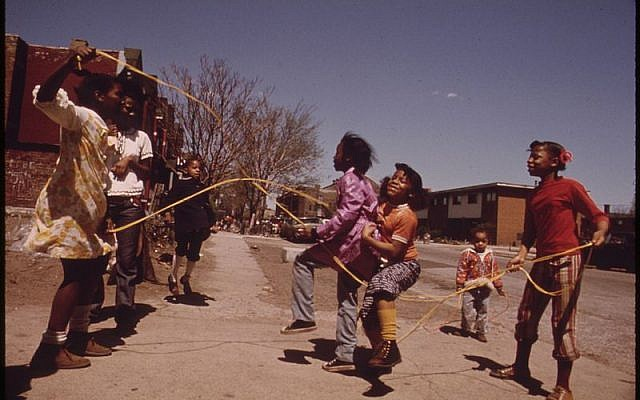 Girls playing double Dutch outside The Ida B. Wells Homes in Chicago, 1973. Photo by John H. White. Wikipedia.