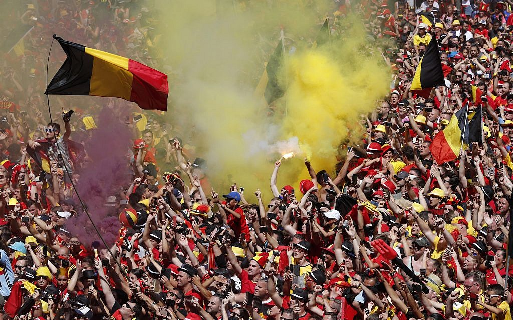 Illustrative: Belgian soccer team fans wait for the team to appear on the balcony of the city hall at the Grand Place in Brussels, Sunday, July 15, 2018 during the World Cup 2018. (Yves Herman, Pool Photo via AP)