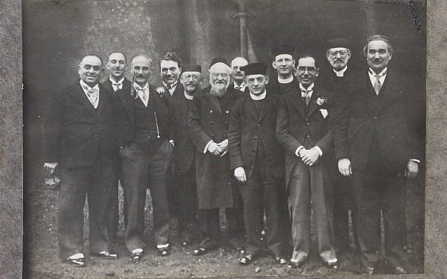 Photograph of members and clergy of Cardiff's Jewish community; identified: Abe Schwartz, JE Rivlin, the Reverend Harris Jerevitch, the Reverend Gershon Grey, MJ Cohen, the Rabbi of Newport (name unknown), the Reverend Harris Hamburg, Alter Rivlin, Rabbi Grunitz; photographer: S Edelman; c.1920; Glamorgan Archives ref. DJR/5/21. (Via Jewish News)