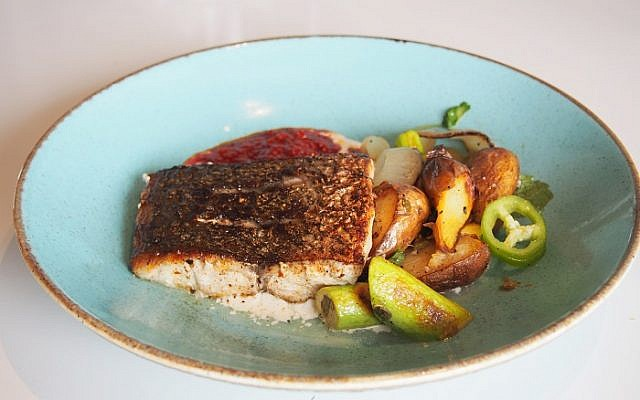 Meagre fillet a la plancha with ratte potatoes and seared baby zucchini on almonds tahini and chermoula.
