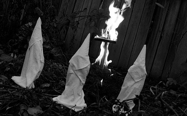 Illustrative image of KKK members and cross burning (iStock)