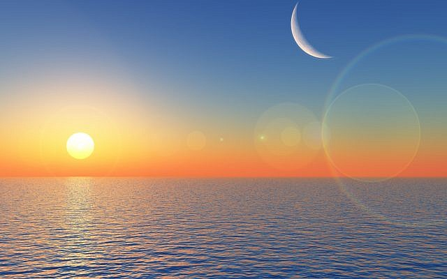 Illustrative. Sunrise over the sea, with a diminished showing by the moon. (iStock)