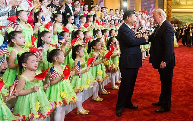 President Donald J. Trump and First Lady Melania Trump, joined by President Xi Jinping and First Lady Peng Liyuan, applaud and thank the performers at a cultural performance at the Great Hall of the People, Thursday, November 9, 2017, following a State Dinner in their honor, in Beijing, People's Republic of China. (Official White House Photo by Andrea Hanks)