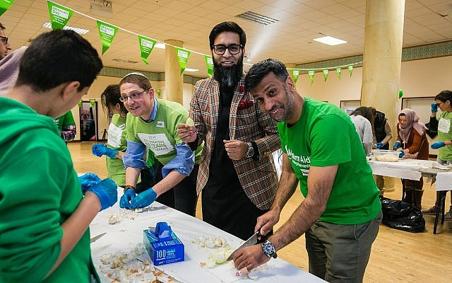 Jehangir Malik (right) getting stuck in to making some chicken soup for Mitzvah Day! Credit: Yakir Zur