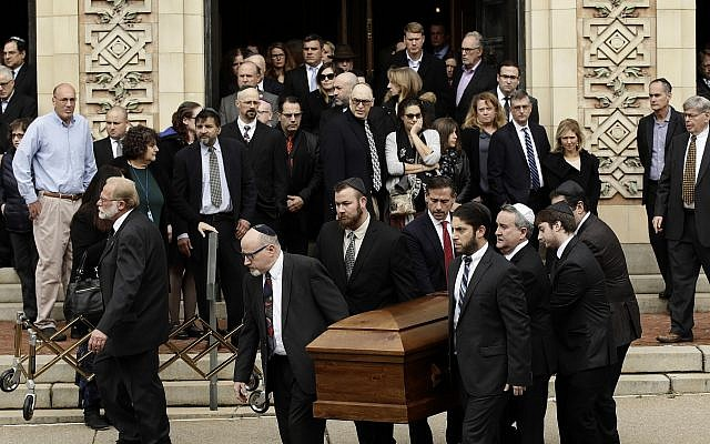 A casket is carried out of Rodef Shalom Congregation after the funeral services for brothers Cecil and David Rosenthal, in Pittsburgh. Oct. 30, 2018. (AP Photo/Matt Rourke, File)