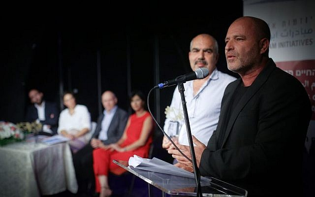 Co-CEO's of Tsofen, Sami Sadi and Paz Hirschmann, give their acceptance speech for the Champions of Shared Society Award, November 13, at the Arab Hebrew Theatre in Jaffa.