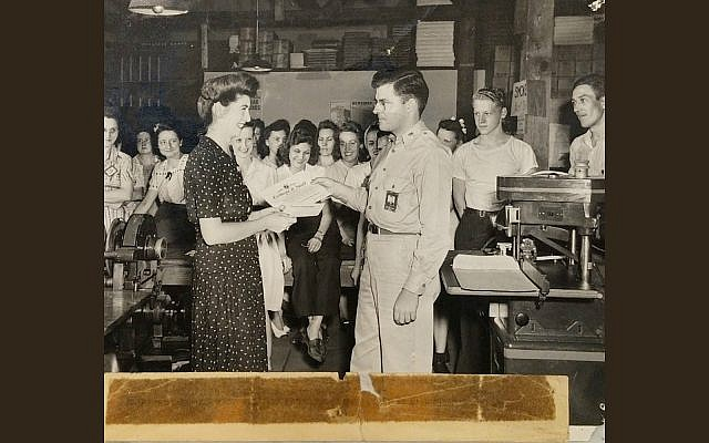 Jeanette Kern, left, receiving one of the two commendations she received for her work during World War II as a clerk in the Army Signal Corps, July 27, 1944. (Courtesy of Oren Hayon)