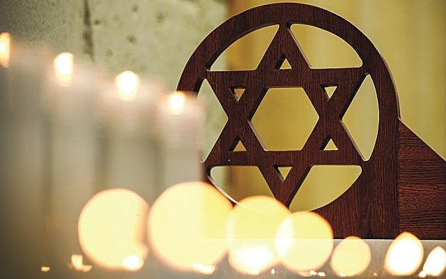 MOSCOW, RUSSIA - OCTOBER 28, 2018: Lit candles at a prayer service at the Moscow Jewish Community Centre for the victims of the 27 October 2018 shooting attack on a synagogue in Pittsburgh, United States. Mikhail Tereshchenko/TASS via Jewish News