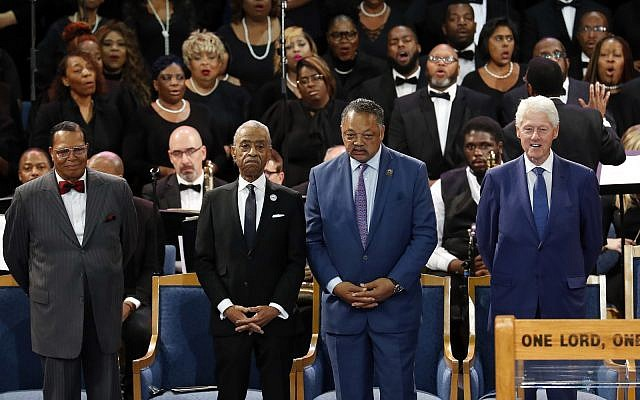 Louis Farrakhan, from left, Rev. Al Sharpton, Rev. Jesse Jackson and former President Bill Clinton attend the funeral service for Aretha Franklin at Greater Grace Temple, August 31, 2018, in Detroit, Michigan. (AP Photo/Paul Sancya)