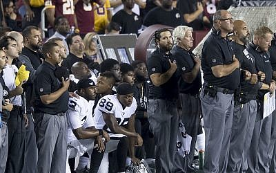 Illustrative. Oakland Raiders players 'take a knee' during the National Anthem, in protest of statements by US President Donald Trump, during week 3 of the 2017 NFL season, on September 24, 2017. (Wikipedia)