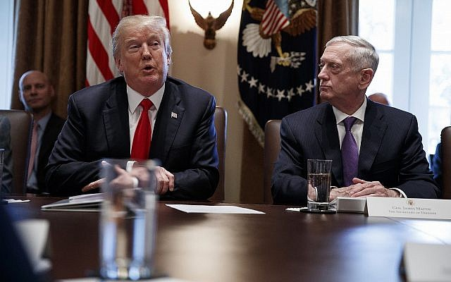 US Defense Secretary Jim Mattis, right, listens to President Donald Trump speak during a cabinet meeting at the White House on January 10, 2018. (AP Photo/Evan Vucci)