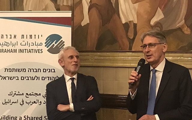 Alex Brummer (left) with chancellor Philip Hammond (right) at the Abraham Initiative dinner